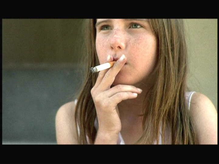 Smoking young teen girl